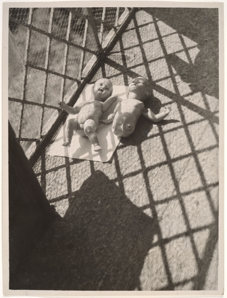 László Moholy-Nagy (American (born Hungary), 1895–1946) Dolls on the Balcony, 1926, Gelatin silver print 23.5 x 17.5 cm (9 1/4 x 6 7/8 in.) The Metropolitan Museum of Art, New York